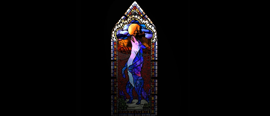 Perils of the Flowerbed poster image. Stained glass window with howling wolf.